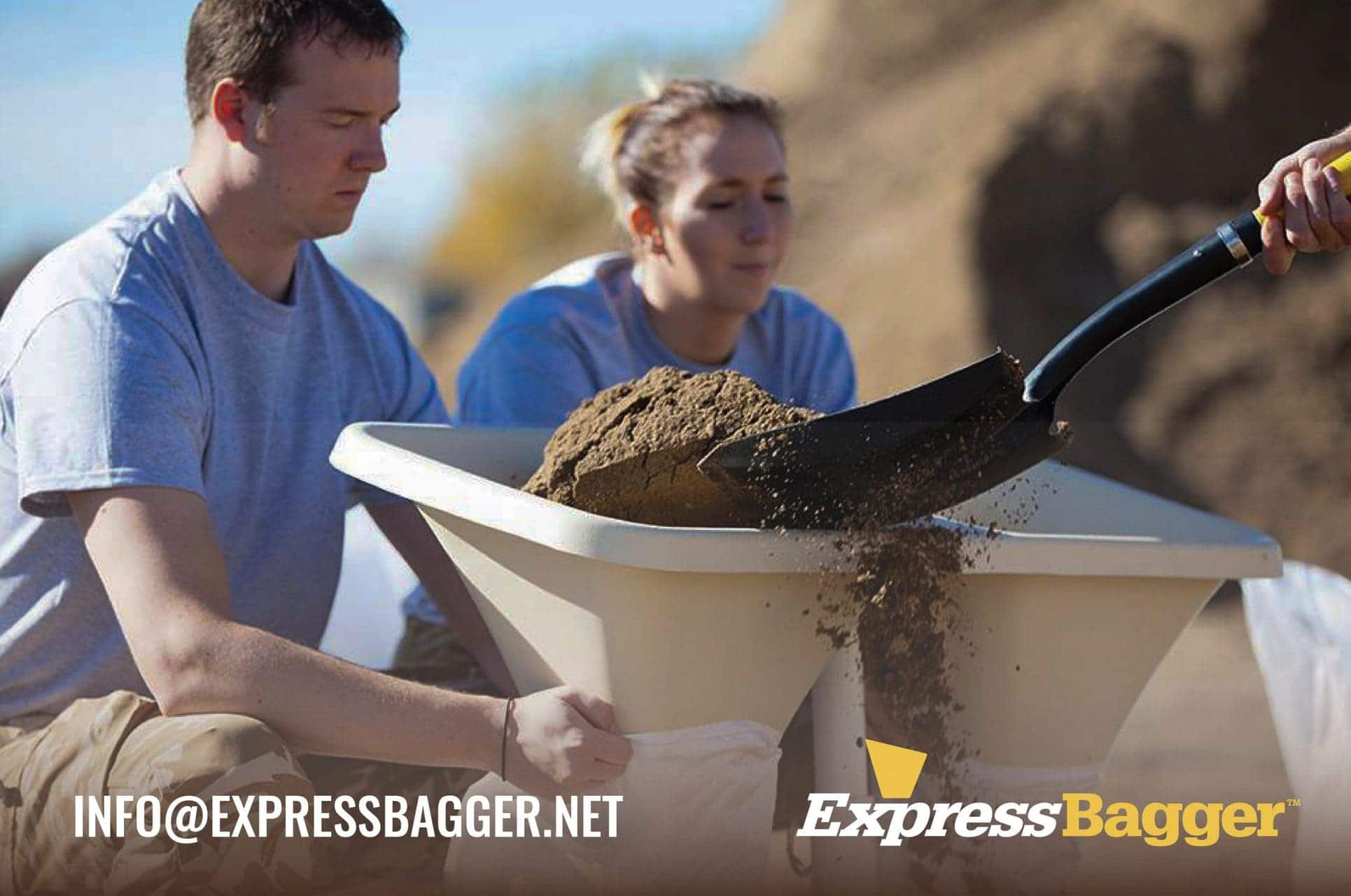 Man and woman using the ExpressBagger Classic sandbag filling tool to fill sandbags while a third man shovels sand